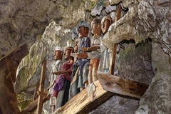 Wooden statues of Tau Tau in TampangAllo burial cave at Tana Toraja. Indonesia Royalty Free Stock Photos