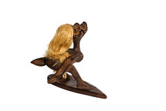 Wooden statuette African surfer Royalty Free Stock Images