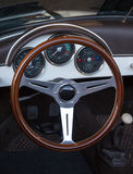 Wooden steering wheel and leather dashboard of a classic vintage Stock Photo