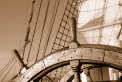 Wooden steering wheel of a sailing ship royalty free stock images