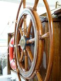 Wooden steering wheel on a sailing ship royalty free stock photo