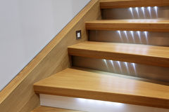 Wooden steps. Staircase with wooden steps and illumination Royalty Free Stock Image