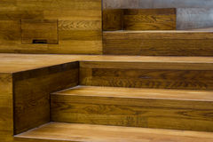 Wooden steps. Modern wooden steps used as a decotation in an office building Stock Images