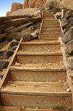 Wooden steps. Steps going up a steep hill Royalty Free Stock Image