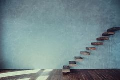 Wooden steps against the gray wall. royalty free stock photos