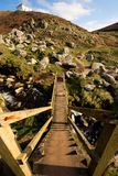 Wooden steps lead down to a Cornish coastal path at Nanjizal beach. Royalty Free Stock Photography