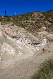 Wooden Steps Leading Down Cliff To Sandy Beach royalty free stock images