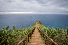 Wooden steps path from Cristo Rei statue to the ocean cape. Stock Image