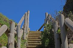 EXTERIOR WOODEN STEPS AND RAILING AT THE COAST Stock Photo