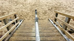 Wooden Steps to Yellow Sand Beach Stock Photos