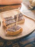 Wooden stick into the chocolate on topping toast Royalty Free Stock Image