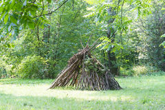 Wooden stick house looking like indian hut, Stock Photos