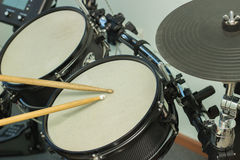 Wooden sticks beat the drums. Two wooden sticks beaten on drums gray Stock Images