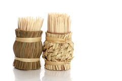 Wooden sticks for cleaning of teeth. (with reflection on white background royalty free stock photos