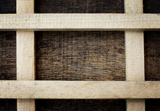 Wooden sticks forming a square. On the old wooden background Stock Photo