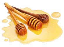 Wooden sticks in the honey puddle. Royalty Free Stock Image