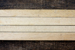 Wooden sticks on old wooden background. Arrangement of wooden sticks on old wooden background Stock Photo