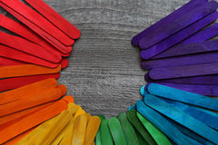 Wooden sticks painted in different colors on a wooden table. Wooden sticks painted in different colors on a grey wooden table Royalty Free Stock Photography
