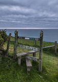 Wooden stile on the Welsh coastal path Stock Photo