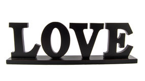 """Wooden Still Life """"LOVE"""". A wooden still life of the """"LOVE"""" isolated on a white background Stock Image"""