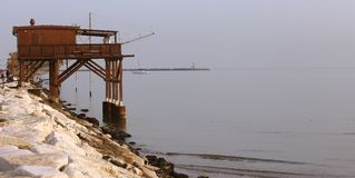Wooden stilt house on the seashore Royalty Free Stock Photography
