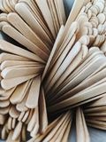 Wooden stir sticks in a swirl royalty free stock image