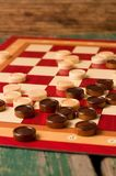 Wooden stones on board for Game of Checkers Royalty Free Stock Image
