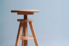 Wooden stool. Three legged stool with adjustable seat Royalty Free Stock Photos