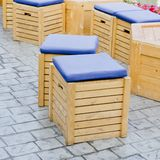 Wooden stool with storage Stock Photos