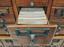 Wooden storage boxes with index book in library Royalty Free Stock Photo