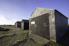 Wooden storage sheds. A row of old wooden storage sheds on a remote farm Stock Images