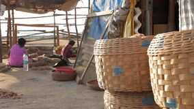 Wooden straw basket kept in front of broken sack house, Mumbai, India