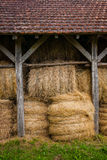 Wooden Straw loft in Dordogne region of France. Bundled straw in a hayloft located in the region of Dordogne in France Royalty Free Stock Photos