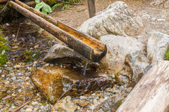 Wooden water pipe Royalty Free Stock Images