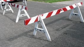 Wooden Street Barriers. On blacktop road Stock Photos