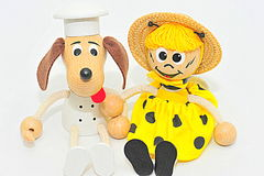 Wooden and string puppets: dog chef and bee Royalty Free Stock Photos