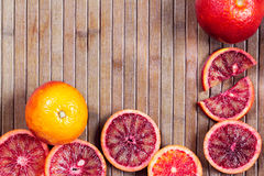 Wooden striped background from cut Sicilian oranges Royalty Free Stock Photography