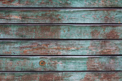 Wooden striped texture. Green with brown wood striped texture royalty free stock photo