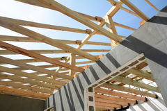 The wooden structure of the building. Installation of wooden beams at construction the roof truss system of the house. royalty free stock image