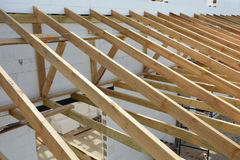 The wooden structure of the building. Wooden frame building. Wooden roof construction. Installation of wooden beams stock photo