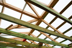 The wooden structure of the building. Wooden frame building. Wooden roof construction. photo for home. house building. Installation of wooden beams at stock photo