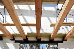 The wooden structure of the building. Wooden roof frame building. TFB system comprises thermo blocks filled with concrete. Stock Image