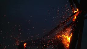 Wooden structure burns with sparks at night.  stock video