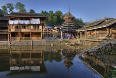 Wooden structure Chinese countryside are reflected in water rive Royalty Free Stock Photo