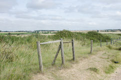 Wooden structure on flat land with fields. Behind royalty free stock images