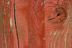 Wooden structure with peeled red paint Stock Photos