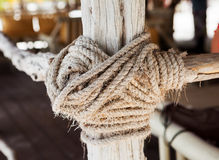 wooden structure with a thick rope close-up Royalty Free Stock Photography