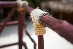 Wooden structure with a thick rope close-up Royalty Free Stock Images
