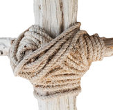 Wooden structure with a thick rope closeup isolated on whote background Royalty Free Stock Photos