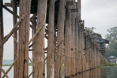 Wooden structure of U Bein Bridge over the Taungthaman Lake royalty free stock photography